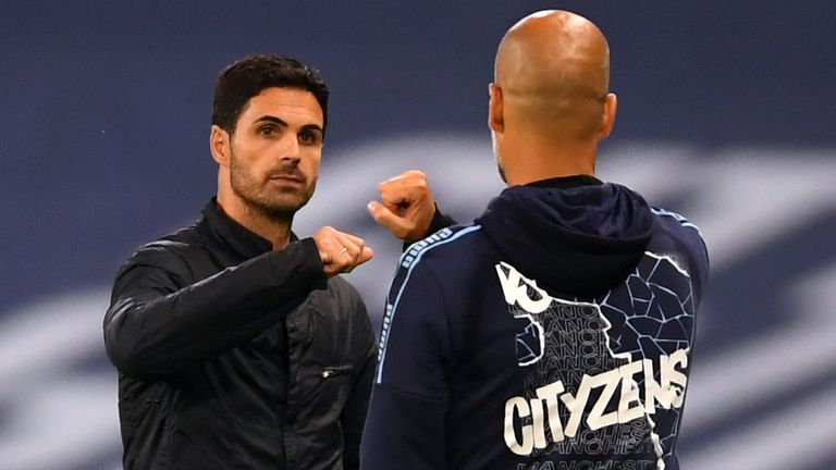 Manchester City manager Pep Guardiola and Arsenal manager Mikel Arteta after City's 3-0 victory